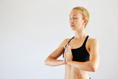 Indoor shot of a young caucasian woman doing yoga Royalty Free Stock Photo
