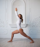 Indoor shot of a young woman doing yoga. Royalty Free Stock Image
