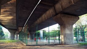 Indoor soccer field under the freeway. expressway. stock photography