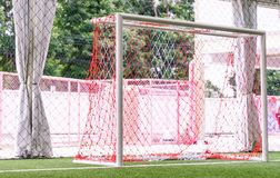 Indoor soccer goal on artifact grass field. Indoor soccer goal net on artifact grass field Royalty Free Stock Images
