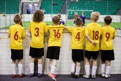 Indoor soccer team. Futsal indoor soccer match for kids stock photography