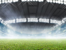 Indoor Stadium Generic. A generic indoor stadium with an unmarked green grass pitch with an eerie mist at night under illuminated floodlights - 3D render royalty free illustration
