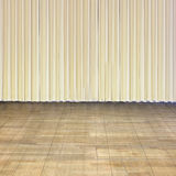 Indoor stage with old wood floor and beige curtain Stock Image