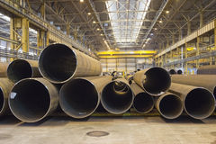 Indoor storage with steel pipes, plant workshop stock photography