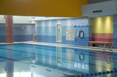 Indoor swiming pool with blue walls stock photo