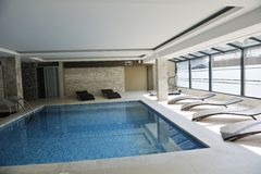 Indoor swimming  pool. Luxuriy swimming pool indoor at wellness and spa center Royalty Free Stock Images