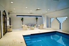 Indoor swimming pool. An Indoor swimming pool with patio Stock Photo