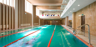 Indoor swimming pool. Swimming pool in a fitness club royalty free stock photo
