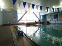 Indoor swimming pool in afternoon light Royalty Free Stock Photo