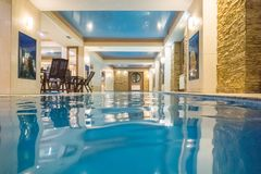Indoor swimming pool in hotel spa center. Spa and Wellness centre with swimming pool, bath, sauna, and restaurant inside Royalty Free Stock Photos