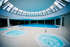 Indoor swimming pool with jacuzzi Royalty Free Stock Images