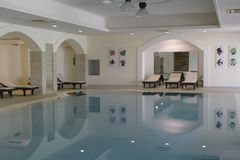Indoor swimming pool in a luxury villa. BRINDISI, ITALY - APR 11 2019 - Indoor swimming pool in a luxury villa hotel near Brindisi, Puglia, Italy stock photo