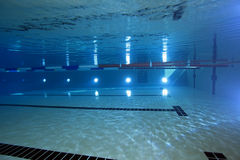 Indoor swimming pool. Scenery underwater Stock Photography