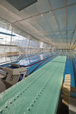 Indoor swimming pool with spring board Royalty Free Stock Photography