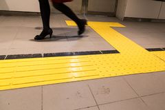 Indoor tactile paving foot path for blind and vision handicap. Indoor tactile paving foot path for the blind and vision impaired handicap in Japan Royalty Free Stock Image