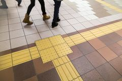 Indoor tactile paving foot path for blind and vision handicap. Indoor tactile paving foot path for the blind and vision impaired handicap in Japan Royalty Free Stock Images