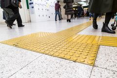 Indoor tactile paving foot path for blind and vision handicap. Indoor tactile paving foot path for the blind and vision impaired handicap in Japan Royalty Free Stock Photos
