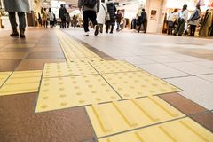 Indoor tactile paving foot path for blind and vision handicap. Indoor tactile paving foot path for the blind and vision impaired handicap in Japan Stock Photo