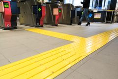 Indoor tactile paving foot path for blind and vision handicap. Indoor tactile paving foot path for the blind and vision impaired handicap in Japan Royalty Free Stock Photo