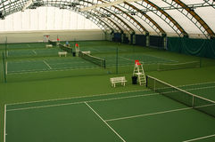 Indoor tennis court. Covered with a green coating Royalty Free Stock Photo
