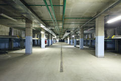Indoor two-level parking with electrolifts for many cars. Stock Photography