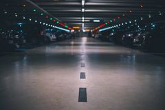 Indoor underground parking lot with blurred background low shot and perspective stock image