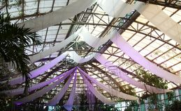 Indoor venue wedding event. Glass ceiling with drpes Stock Image
