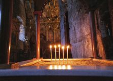 Candles light inside of historical ancient sight church of Saint Lazarus, Cyprus royalty free stock images