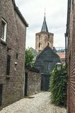 Old dutch houses with church tower. Indoor view of old dutch houses with a church tower in the background Royalty Free Stock Image
