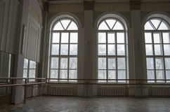 A large hall with high windows and a high ceiling for practicing ballroom dancing and choreography. stock photography
