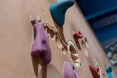Indoor wall climbing grips close up stock images