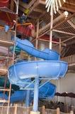 Indoor Waterpark or Water Park Slide Splash Fun. An indoor water park slide. A waterpark is a place filled with fun Stock Image