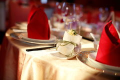 Indoor wedding scene. Wedding table set for dining,an indoor wedding party Royalty Free Stock Photo