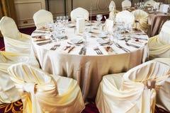 Indoor wedding table with beige decoration Stock Photos