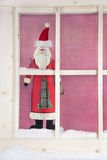 Indoor window sill Christmas decoration: wooden santa claus Stock Photo