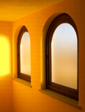 Indoor windows. Two Indoor windows with yellow walls Royalty Free Stock Photo