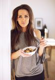 Indoor Woman Eating Cereal Royalty Free Stock Images