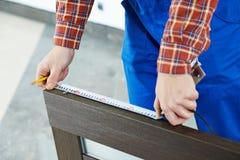 Indoor wood door installation Stock Photo