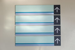 Indoor wooden sign with arrows straight. Stock Photography