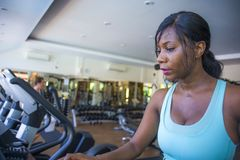 Indoors gym portrait of young attractive and happy black afro American woman training sweaty at fitness club a treadmill running w. Orkout in body care and stock images