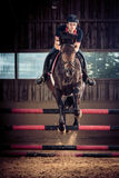 Indoors Horse Jumping Royalty Free Stock Photo