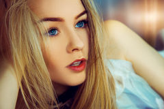 Indoors portrait of beauty young woman with blue eyes Royalty Free Stock Photo