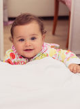 Indoors portrait of smiling cute little girl Royalty Free Stock Photography