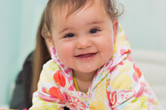 Indoors portrait of smiling cute little girl Royalty Free Stock Images