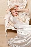 Indoors shot in the Marie Antoinette style. Beautiful woman dressed up like  Marie Antoinette posing in the interior Royalty Free Stock Images