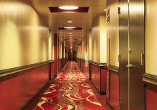 Indoors View of Long Hotel Corridor Stock Photography