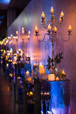Indoors wedding decoration with candles and fir branches