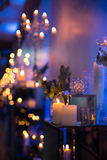 Indoors wedding decoration in the evening with candles