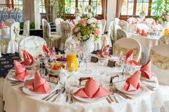 Indoors wedding reception with decor. Wedding hall Stock Image