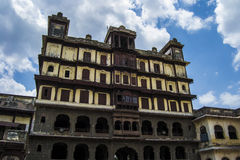 Indore Heritage Palace. Interior of Royal Palace Rajbada Rajwada of Indore Madhya Pradesh showing blue sky and white clouds in background Royalty Free Stock Images